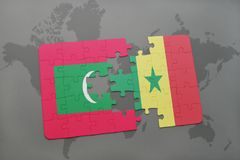 Puzzle with the national flag of maldives and senegal on a world map. Background. 3D illustration Royalty Free Stock Image