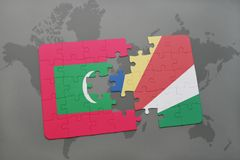 Puzzle with the national flag of maldives and seychelles on a world map. Background. 3D illustration Royalty Free Stock Photo