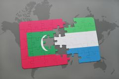 Puzzle with the national flag of maldives and sierra leone on a world map. Background. 3D illustration Royalty Free Stock Photo