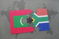 Puzzle with the national flag of maldives and south africa on a world map Royalty Free Stock Photography