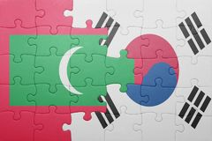 Puzzle with the national flag of maldives and south korea. Concept stock photos