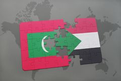 Puzzle with the national flag of maldives and sudan on a world map Stock Photo