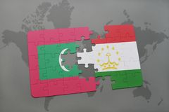 Puzzle with the national flag of maldives and tajikistan on a world map background. 3D illustration Stock Image