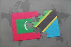 Puzzle with the national flag of maldives and tanzania on a world map Royalty Free Stock Photos