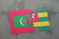 Puzzle with the national flag of maldives and togo on a world map. Background. 3D illustration Royalty Free Stock Photos