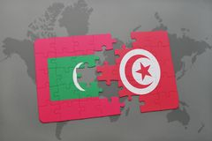 Puzzle with the national flag of maldives and tunisia on a world map. Background. 3D illustration Royalty Free Stock Photos