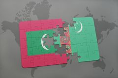 Puzzle with the national flag of maldives and turkmenistan on a world map background. 3D illustration Royalty Free Stock Photos