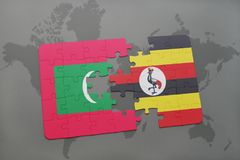 Puzzle with the national flag of maldives and uganda on a world map. Background. 3D illustration Royalty Free Stock Photography