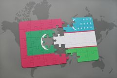 Puzzle with the national flag of maldives and uzbekistan on a world map background. 3D illustration Stock Image