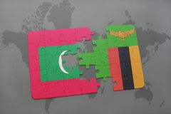 Puzzle with the national flag of maldives and zambia on a world map. Background. 3D illustration Royalty Free Stock Image