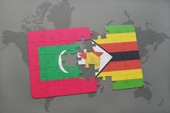 Puzzle with the national flag of maldives and zimbabwe on a world map. Background. 3D illustration Royalty Free Stock Images