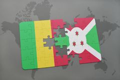Puzzle with the national flag of mali and burundi on a world map Royalty Free Stock Photography