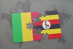 Puzzle with the national flag of mali and uganda on a world map Royalty Free Stock Photo