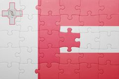 Puzzle with the national flag of malta and austria. Concept Royalty Free Stock Photos