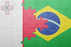 Puzzle with the national flag of malta and brazil. Concept Stock Photography