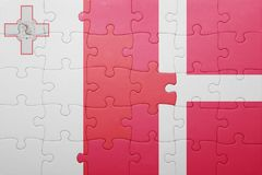 Puzzle with the national flag of malta and denmark. Concept Royalty Free Stock Images