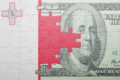 Puzzle with the national flag of malta and dollar banknote. Concept Royalty Free Stock Images