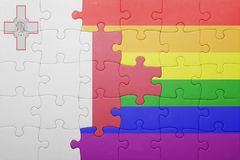 Puzzle with the national flag of malta and gay flag. Concept Royalty Free Stock Images