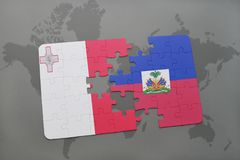 Puzzle with the national flag of malta and haiti on a world map Stock Photo