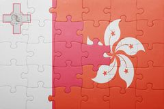 Puzzle with the national flag of malta and hong kong. Concept Stock Photos
