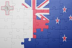 Puzzle with the national flag of malta and new zealand. Concept Stock Images