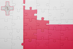 Puzzle with the national flag of malta and poland. Concept Royalty Free Stock Photos