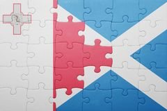 Puzzle with the national flag of malta and scotland. Concept Stock Photography