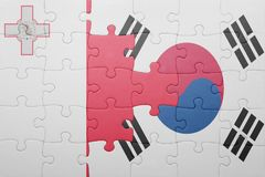 Puzzle with the national flag of malta and south korea. Concept Royalty Free Stock Image