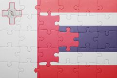 Puzzle with the national flag of malta and thailand. Concept Stock Image