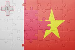 Puzzle with the national flag of malta and vietnam. Concept Stock Images