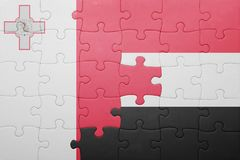 Puzzle with the national flag of malta and yemen. Concept Stock Image