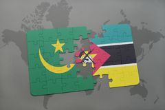 Puzzle with the national flag of mauritania and mozambique on a world map Stock Photography