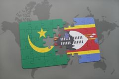 Puzzle with the national flag of mauritania and swaziland on a world map Stock Photos
