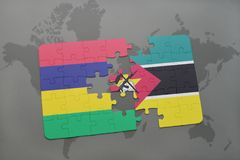 Puzzle with the national flag of mauritius and mozambique on a world map. Background. 3D illustration Royalty Free Stock Photos