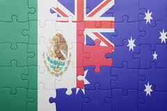 Puzzle with the national flag of mexico and australia. Concept royalty free stock images