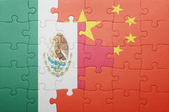 Puzzle with the national flag of mexico and china. Concept Stock Image