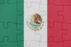 Puzzle with the national flag of mexico. Concept stock photography