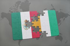Puzzle with the national flag of mexico and cote divoire on a world map background. 3D illustration Royalty Free Stock Images