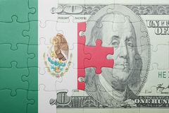 Puzzle with the national flag of mexico and dollar banknote. Concept stock images