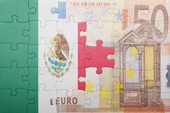 Puzzle with the national flag of mexico and euro banknote. Concept Royalty Free Stock Image