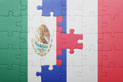 Puzzle with the national flag of mexico and france. Concept stock images