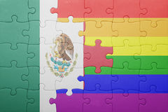 Puzzle with the national flag of mexico and gay flag. Concept stock photo