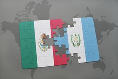 Puzzle with the national flag of mexico and guatemala on a world map background. 3D illustration royalty free stock photo