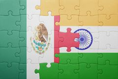Puzzle with the national flag of mexico and india. Cotncept stock image