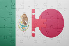 Puzzle with the national flag of mexico and japan. Concept royalty free stock photography