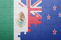 Puzzle with the national flag of mexico and new zealand. Concept Stock Images
