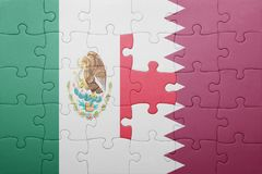 Puzzle with the national flag of mexico and qatar. Concept stock photography