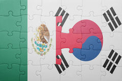 Puzzle with the national flag of mexico and south korea. Concept stock photography