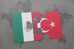 Puzzle with the national flag of mexico and turkey on a world map background. 3D illustration royalty free stock photos