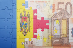 Puzzle with the national flag of moldova and euro banknote Stock Photo